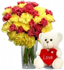 Red N Yellow Carnations In A Vase With Teddy