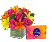 Mix Lilies N Roses In A Vase With Chocolates