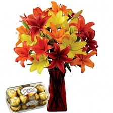Bright Lilies In A Vase With Chocolates