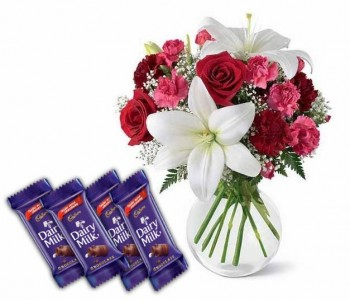 Lilies, Roses , Carnation and Chocolates