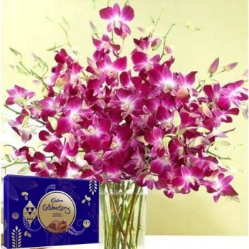 Orchids in A Vase With Chocolates
