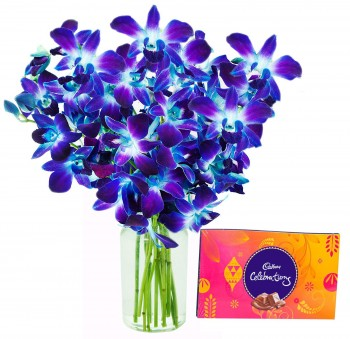 Blue Orchids In A Vase N Chocolates